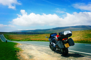 Motorbike on road with view of viaduct